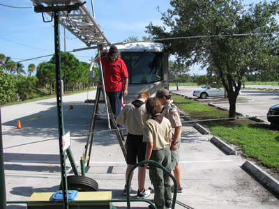 Lee Pennington K4LJP and the Scouts putting together the tower trailer for the Lighthouse event in 2
